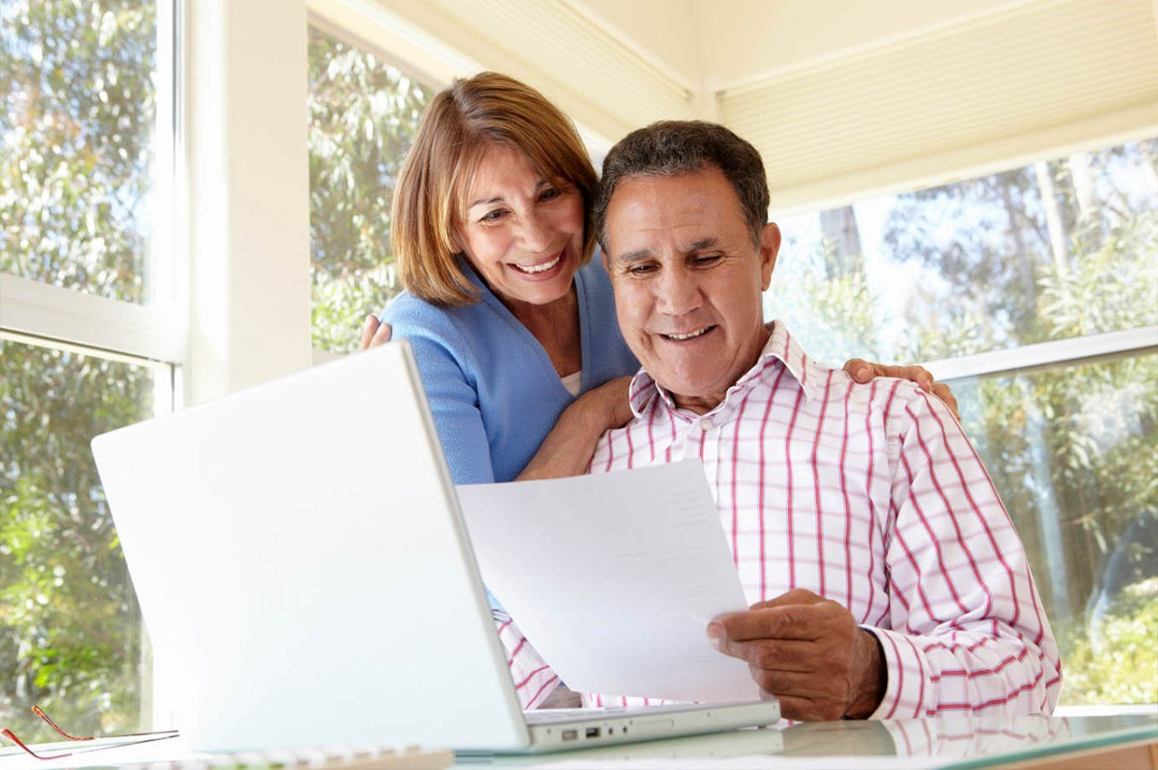 couple reading documents