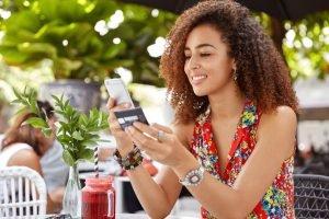 woman using debit card