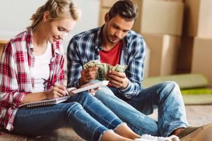 couple holding cash