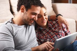 young couple on tablet
