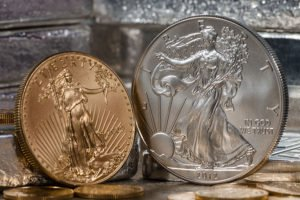 gold and silver American eagle coins